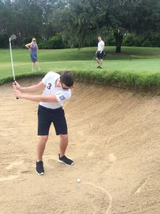 Greg attempting a sand wedgie while bunkered. He spent a lot of time in bunkers and grew very fond of them.