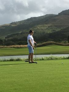 Ed striking a golfing pose