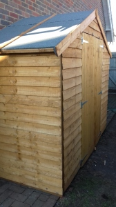 One completed, square, rectangular shed!